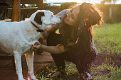 istock Smiling Young Woman Embracing a Dog 954134796