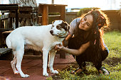 istock Smiling Young Woman Embracing a Dog 954413712
