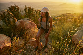 istock Smiling young woman hiking rocky trail near san diego 849486964
