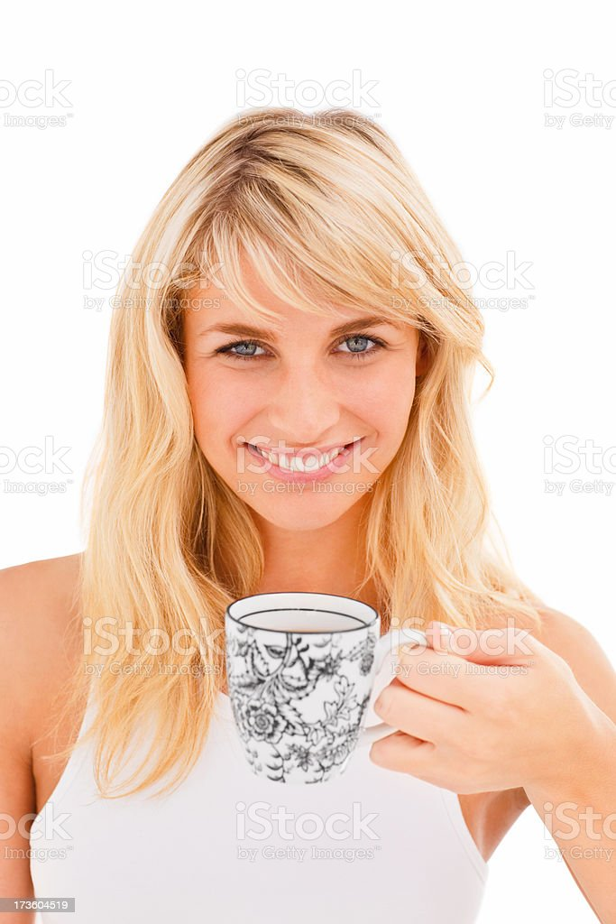 Smiling young woman holding a cup of coffee royalty-free stock photo