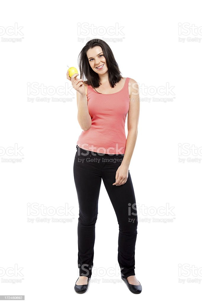Smiling young woman holding an apple in hand over white royalty-free stock photo