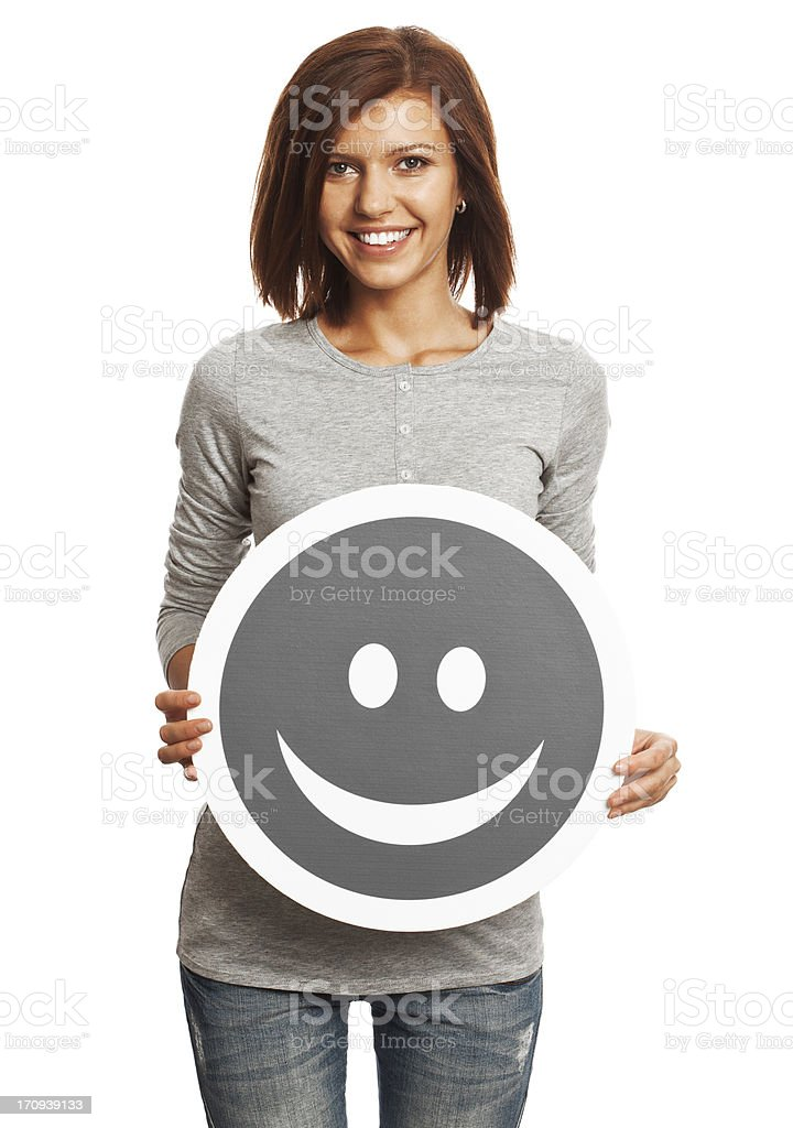 Smiling young woman holding happy smile sign isolated on white. royalty-free stock photo
