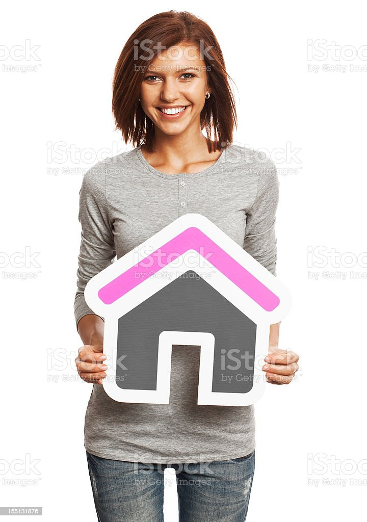 Smiling young woman holding house sign isolated on white background royalty-free stock photo