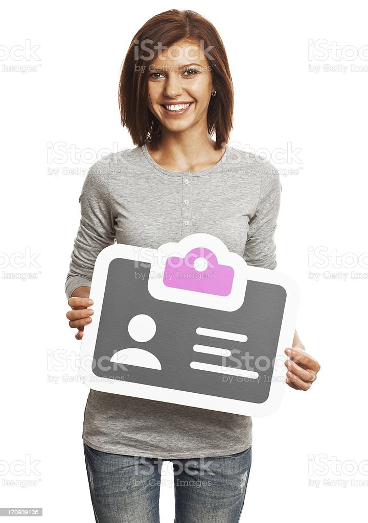 Smiling young woman holding identification card sign isolated on white. stock photo