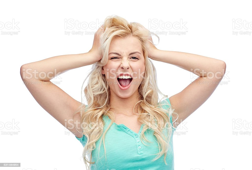 smiling young woman holding to her head or hair stock photo
