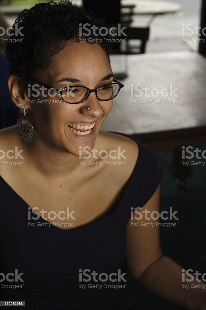 smiling young woman in a coffee shop royalty-free stock photo