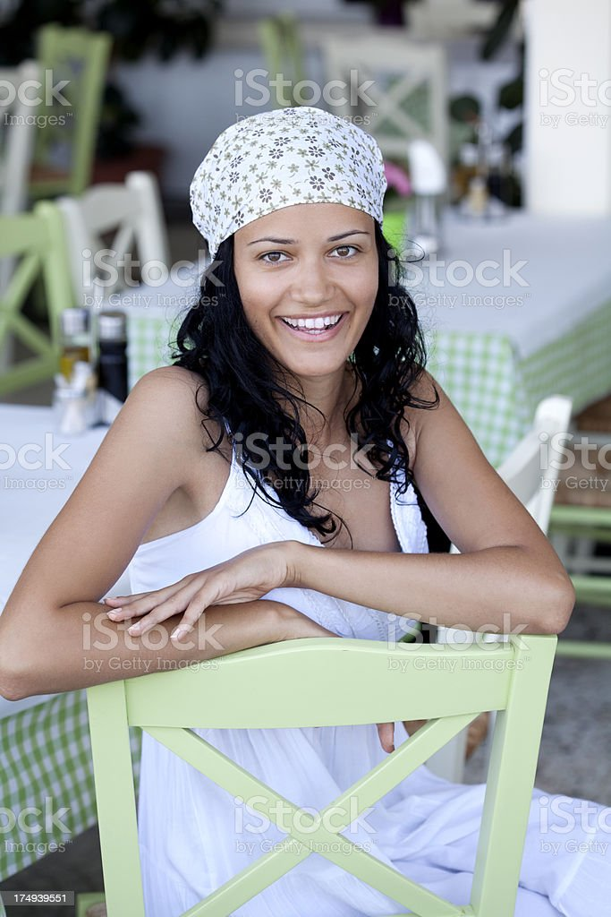 smiling young woman in a restaurant royalty-free stock photo