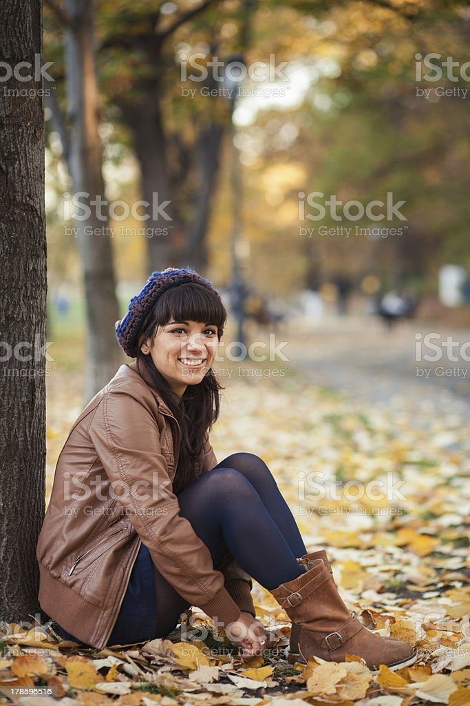 Smiling young woman in autumn. royalty-free stock photo