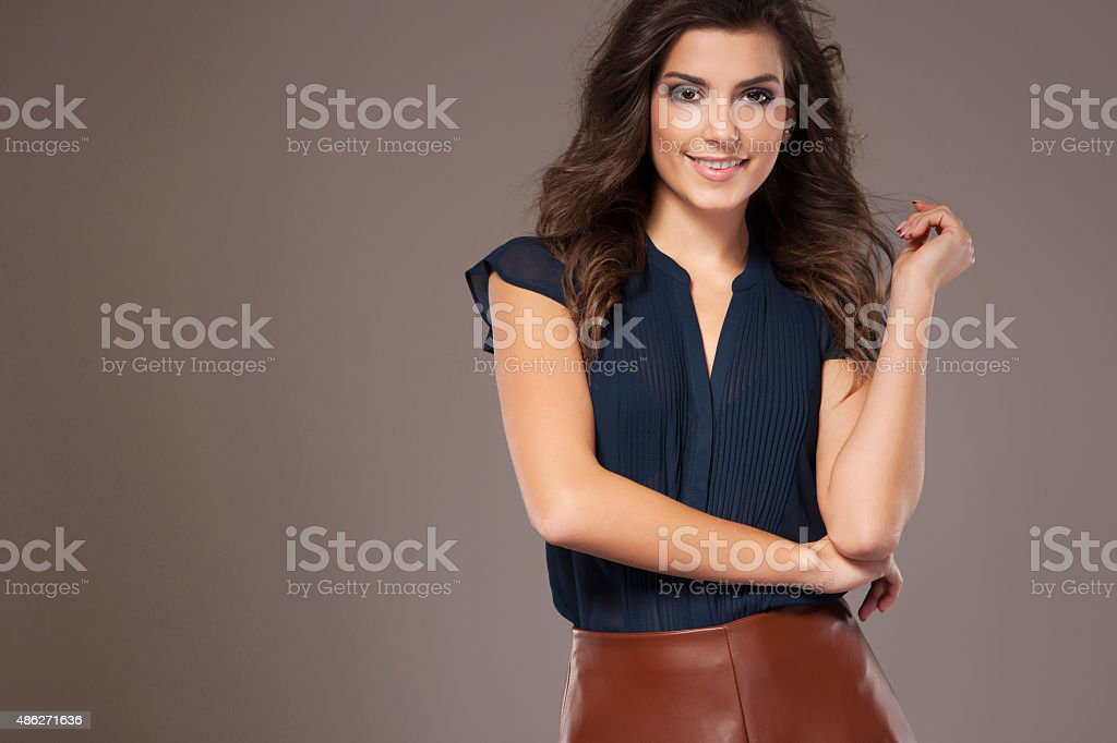Smiling young woman in stylish clothes stock photo