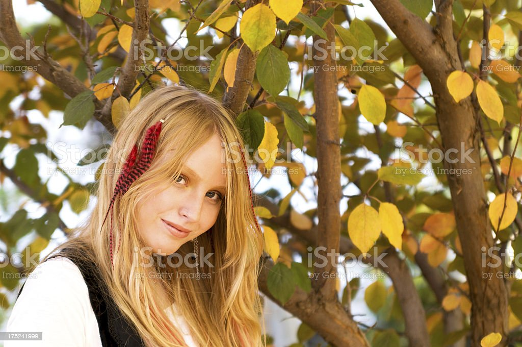 Smiling young woman in warm autumn light. royalty-free stock photo