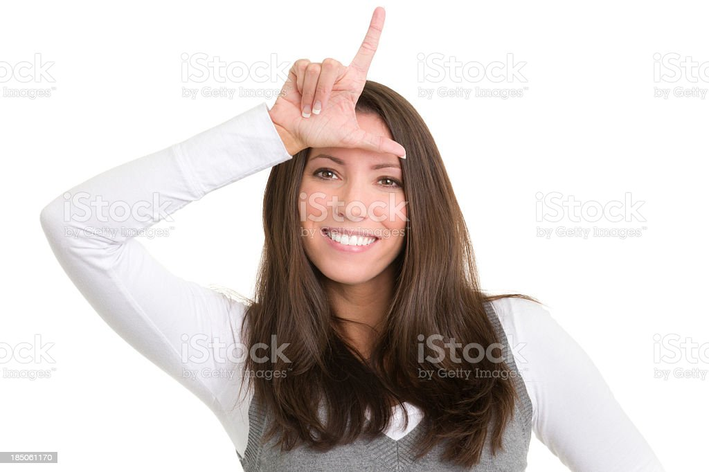Smiling Young Woman Loser Gesture Hand Sign stock photo