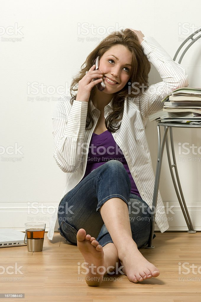 smiling young woman on the phone stock photo