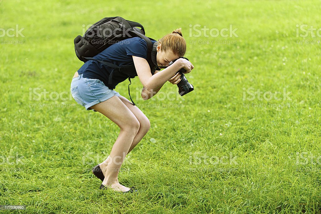 smiling young woman photographs on camera stock photo