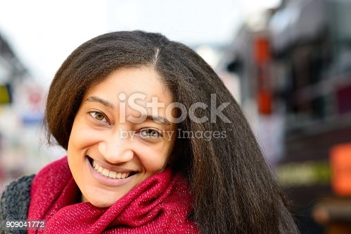 518885222istockphoto Smiling young woman 909041772