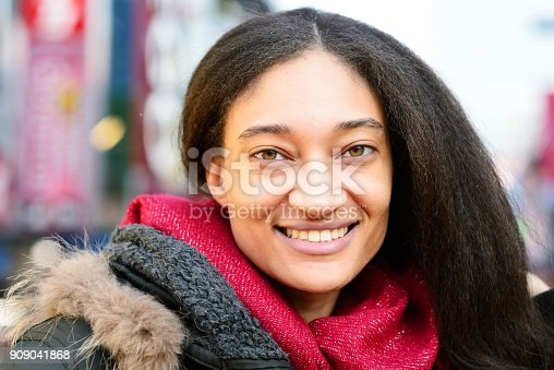 518885222istockphoto Smiling young woman 909041868