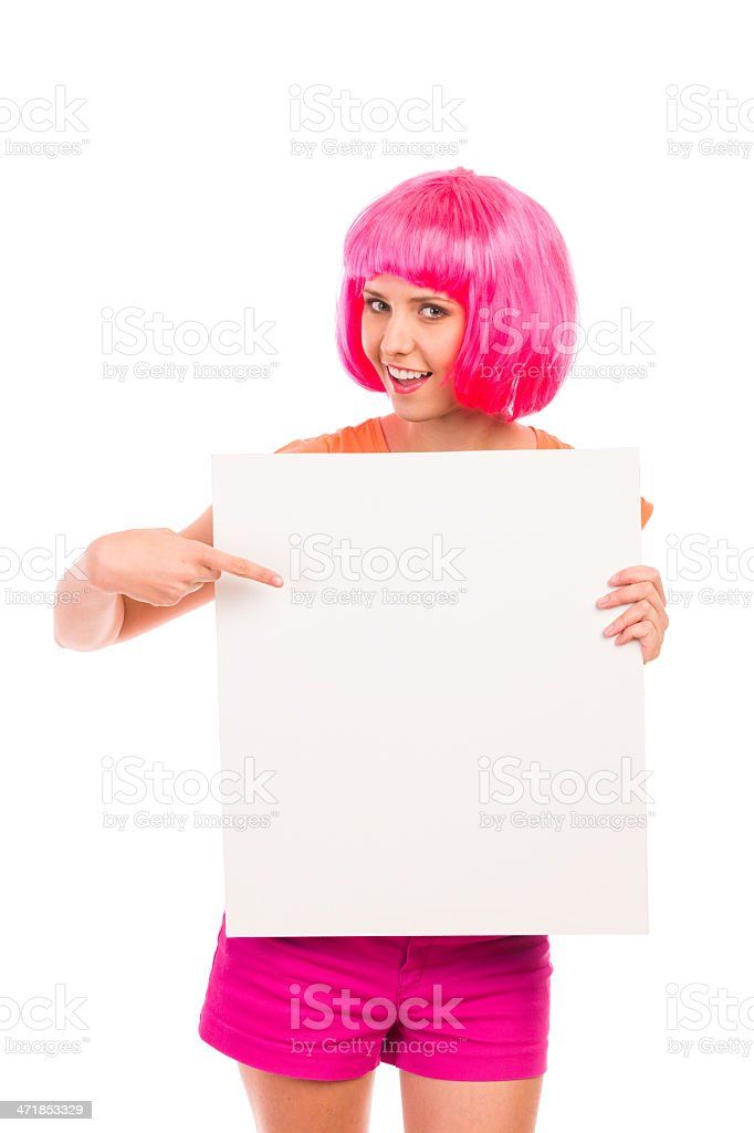 Smiling young woman pointing at blank board. royalty-free stock photo