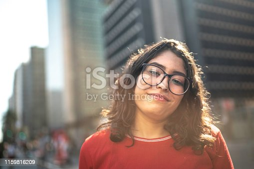 Smiling young woman portrait in the city