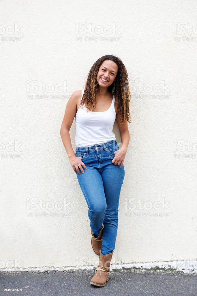 Smiling young woman posing outdoors stock photo