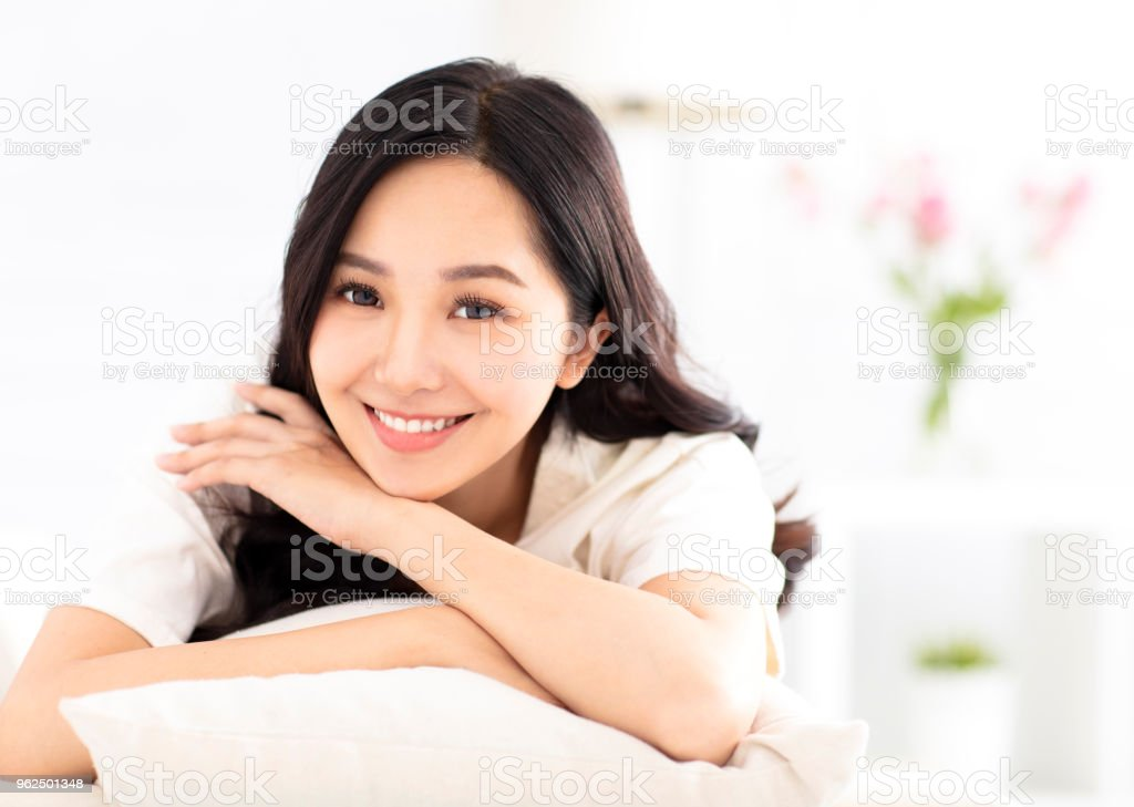 smiling young woman relax on the sofa - Royalty-free Adult Stock Photo