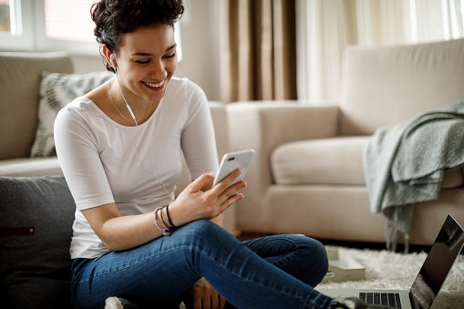 Smiling young woman relaxing at home