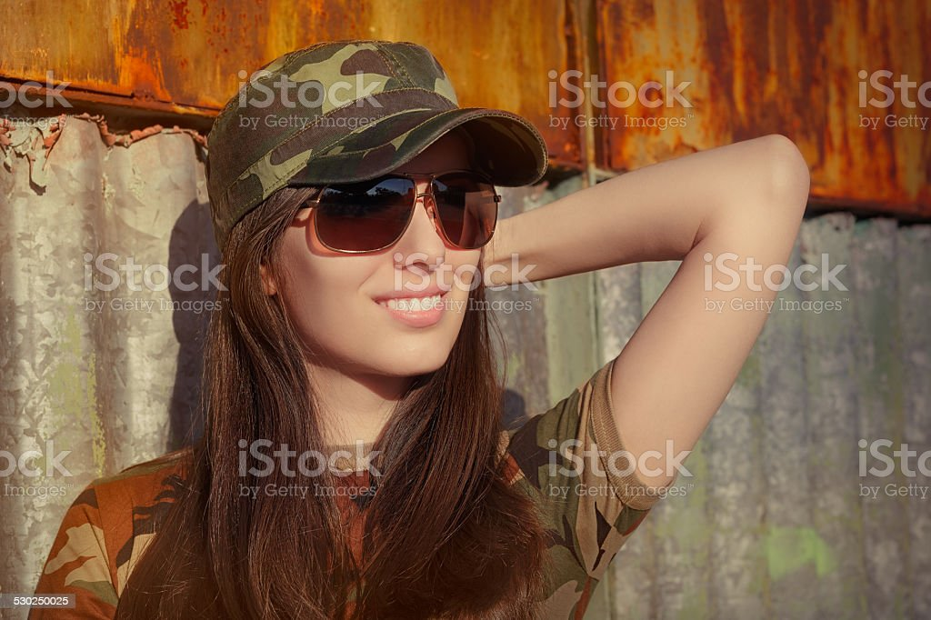Smiling Young Woman Soldier in Camouflage Outfit stock photo