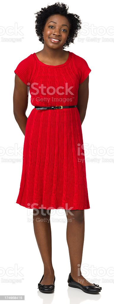 Smiling Young Woman Standing In Red Dress stock photo