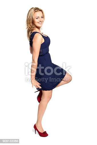 istock Smiling Young Woman Standing on One Leg 909133086