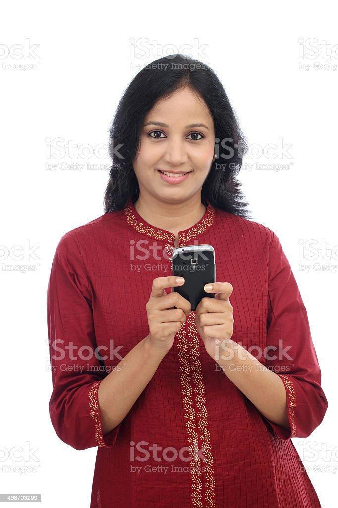 Smiling young woman text messaging stock photo