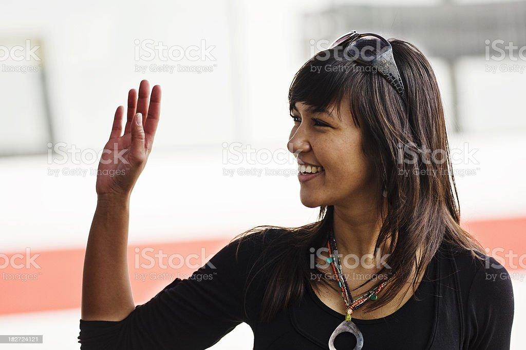 Smiling Young Woman Waving Goodbye Waiting royalty-free stock photo