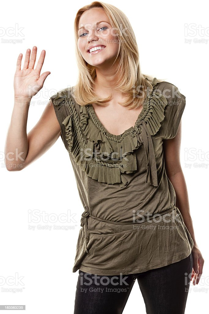 Smiling Young Woman Waving Hello or Goodbye stock photo
