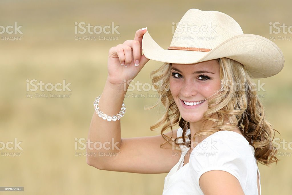 Smiling young woman wearing a cowboy hat royalty-free stock photo