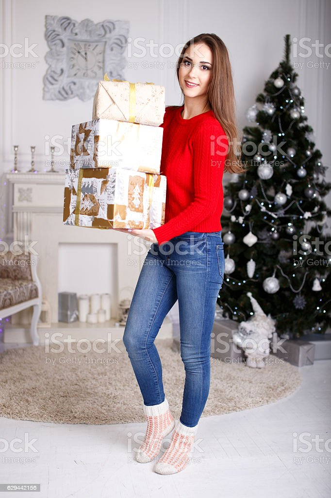 Smiling Young Woman With A Christmas Gifts And Christmas Tree Stock ...