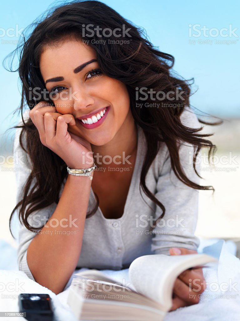 Smiling young woman with book royalty-free stock photo