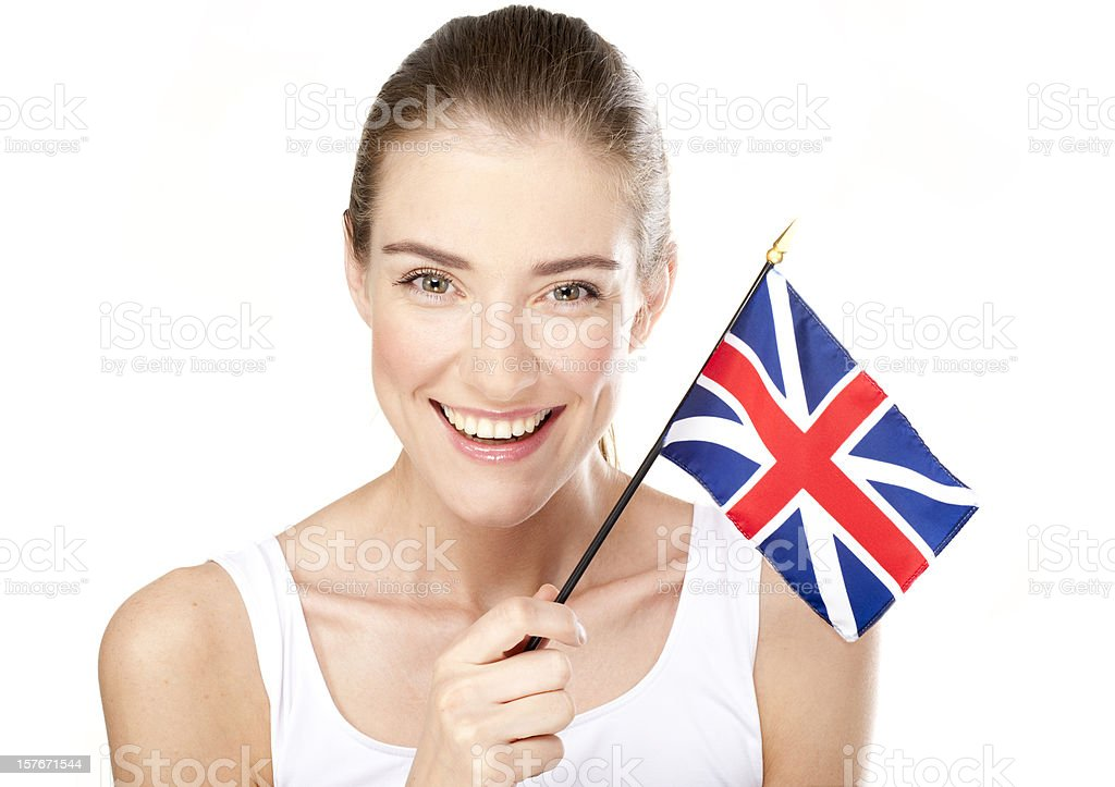 Smiling young woman with British flag royalty-free stock photo