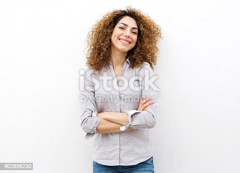 istock smiling young woman with curly hair against white background 902856230