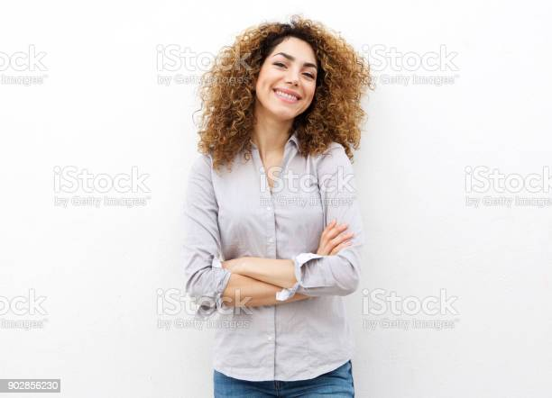 Smiling young woman with curly hair against white background picture id902856230?b=1&k=6&m=902856230&s=612x612&h=p0hhwqb05xagcnxrqgagsfy83yleqz8rpgaayieh4le=