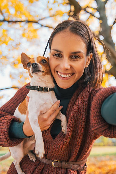 Smiling young woman with dog outdoors in autumn making selfie picture id527958851?b=1&k=6&m=527958851&s=612x612&w=0&h=oxwa93iy4dnpf4h6lhyqtst13uwbrl2589tnnvm5oha=