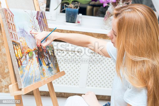 istock Smiling young woman with eyeglasses drawing 683352732