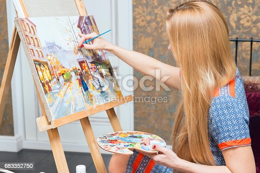 istock Smiling young woman with eyeglasses drawing 683352750