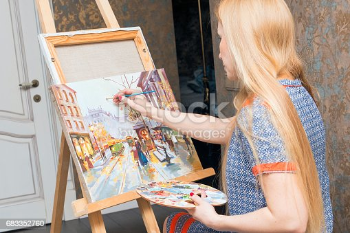 istock Smiling young woman with eyeglasses drawing 683352760