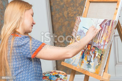 istock Smiling young woman with eyeglasses drawing 683352772
