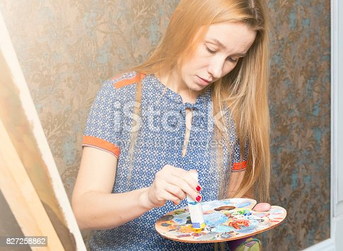 istock Smiling young woman with eyeglasses drawing 827258862