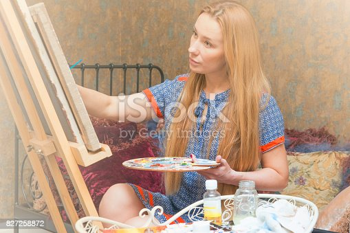 istock Smiling young woman with eyeglasses drawing 827258872