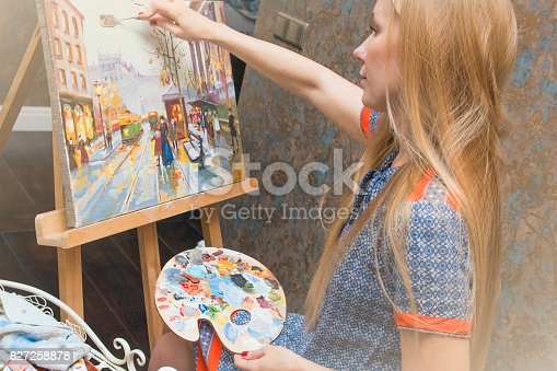 istock Smiling young woman with eyeglasses drawing 827258878