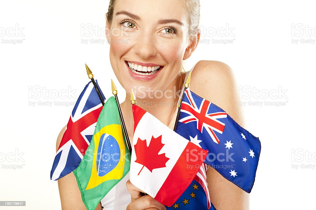 smiling young woman with  flags royalty-free stock photo