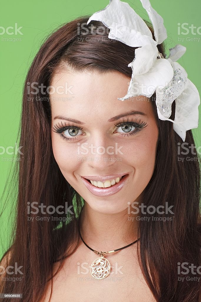 Smiling young woman with flower royalty-free stock photo