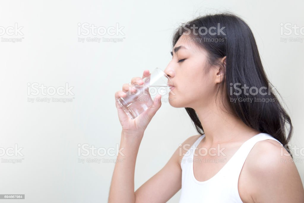 Smiling Young Woman With Glass Of Fresh Water stock photo