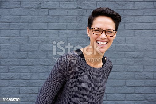 510397772 istock photo Smiling young woman with glasses 510398792