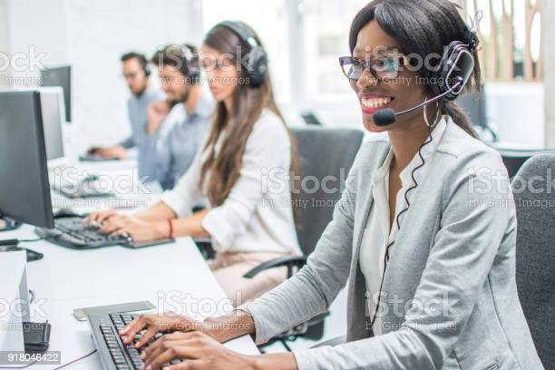 Smiling young woman with headset working in call center picture id918046422?b=1&k=6&m=918046422&s=612x612&h=a1es5kk7ibfgm2d yjgkxg2gc83znond4yccj wcrwa=