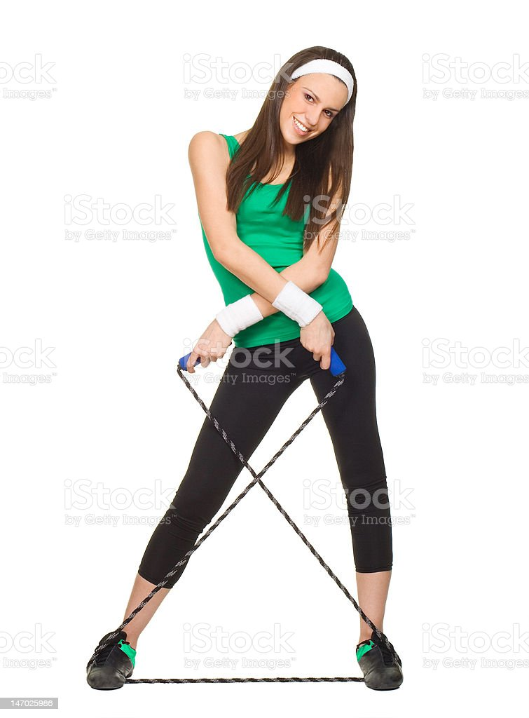 Smiling young woman with jump rope royalty-free stock photo
